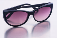 Sunglasses from plastic on a surface from steel Royalty Free Stock Photography