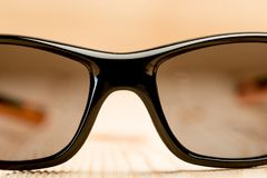 Sunglasses with polarizing glasses lie on a wooden surface, phot. Ographed close-up Royalty Free Stock Photos