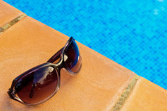 Sunglasses by pool Stock Photo