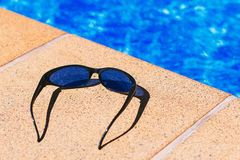 Sunglasses in the pool Stock Images