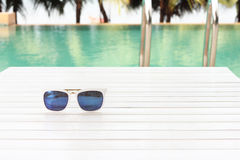 Sunglasses by the pool Stock Photography