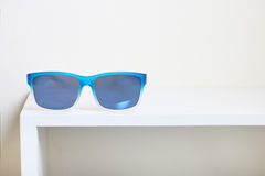 Sunglasses on the rack. Royalty Free Stock Photography