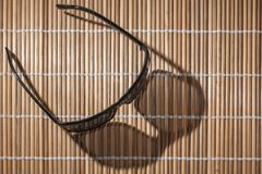 Sunglasses on reed mat straight royalty free stock photos