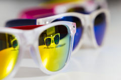 Sunglasses reflected on colorful mirror sunglasses Stock Images