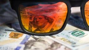 Sunglasses reflecting money Royalty Free Stock Photo