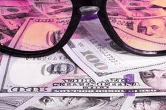 Sunglasses reflecting money Royalty Free Stock Photos