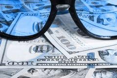 Sunglasses reflecting money Royalty Free Stock Image
