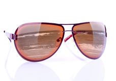 The sunglasses with reflecting seashore Royalty Free Stock Images