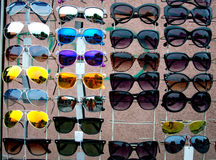 Sunglasses reflecting the street life Stock Images