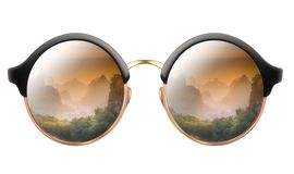 Sunglasses with reflection of cloudy mountains royalty free stock images