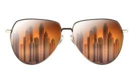 Sunglasses with reflection of Dubai Marina Bay royalty free stock photography