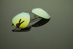 Sunglasses. With a reflection of the hand on a dark background Stock Image