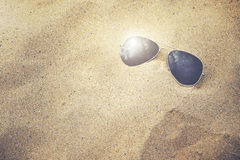 Sunglasses. With reflection on the sand beach Royalty Free Stock Photography