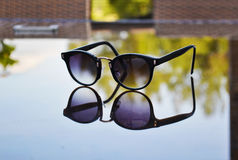 Sunglasses reflection on table Royalty Free Stock Photos