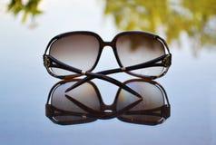 Sunglasses reflection on table Stock Photos