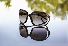 Sunglasses reflection on table Stock Image