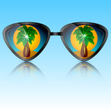 Sunglasses with reflection of trees Royalty Free Stock Photography