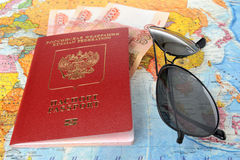 Sunglasses and Russian international passport with money on the Royalty Free Stock Image