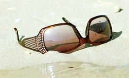 Sunglasses on the sand Stock Photo