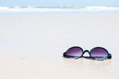 Sunglasses in the sand at the beach.  Stock Photo