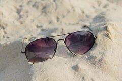 Sunglasses on the sand beach Stock Photography
