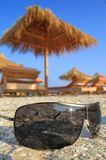 Sunglasses in the sand. Closeup of  black sunglasses in the sand Royalty Free Stock Photos