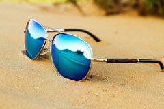 Sunglasses on the sand in the desert. Royalty Free Stock Photo