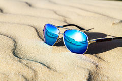 Sunglasses on the sand in the desert. Royalty Free Stock Images