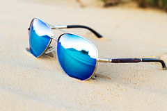 Sunglasses on the sand in the desert. Stock Photos