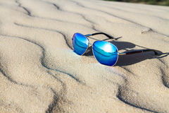 Sunglasses on the sand in the desert. Stock Images