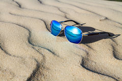 Sunglasses on the sand in the desert. Royalty Free Stock Photos