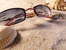 Sunglasses on sand Stock Image