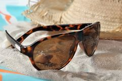 Sunglasses on the sand Royalty Free Stock Photography