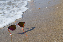 Sunglasses in the sand Stock Photography