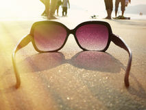 Sunglasses on the sand Stock Images