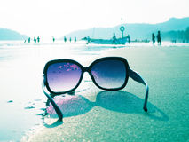Sunglasses on the sand Royalty Free Stock Photos