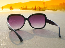Sunglasses on the sand Stock Photography