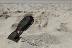 Sunglasses on the sand Royalty Free Stock Image