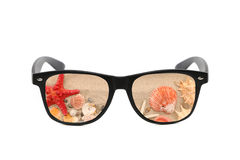 Sunglasses with sand reflection. Stock Image
