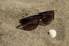 Sunglasses on the sand Stock Image