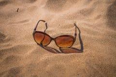 Sunglasses on the sand. Solar sunglasses on the sand Stock Photo