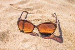 Sunglasses on the sand. Solar sunglasses on the sand Royalty Free Stock Photography