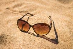 Sunglasses on the sand. Solar sunglasses on the sand Stock Image