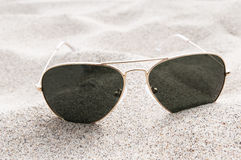 Sunglasses on the sand Royalty Free Stock Images