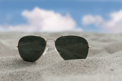 Sunglasses on the sand. In summer Stock Photo