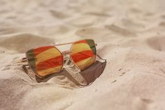 Sunglasses on the sand in summer stock images