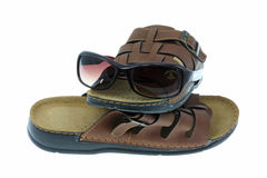 Sunglasses and sandals. Stock Image