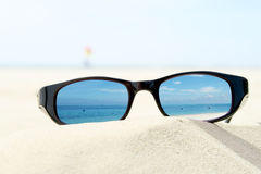 Sunglasses on sandy beach Royalty Free Stock Image