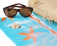 Sunglasses on sarong Stock Photos