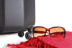 Bon Voyage. Good trip. Sunglasses  on scarf and suitcase Stock Image